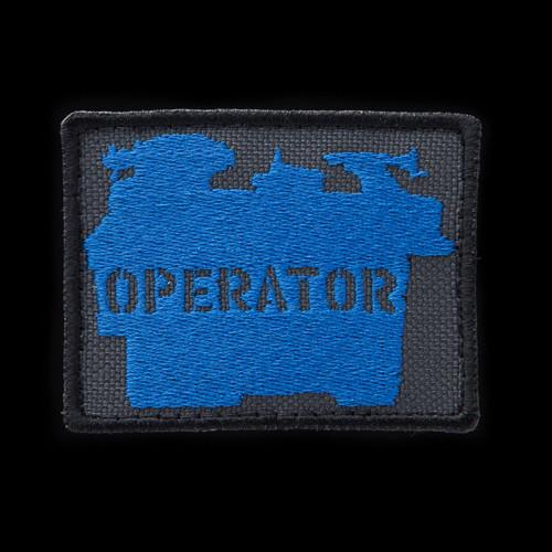 Lathe Operator Patch: charcoal background, blue artwork, black border