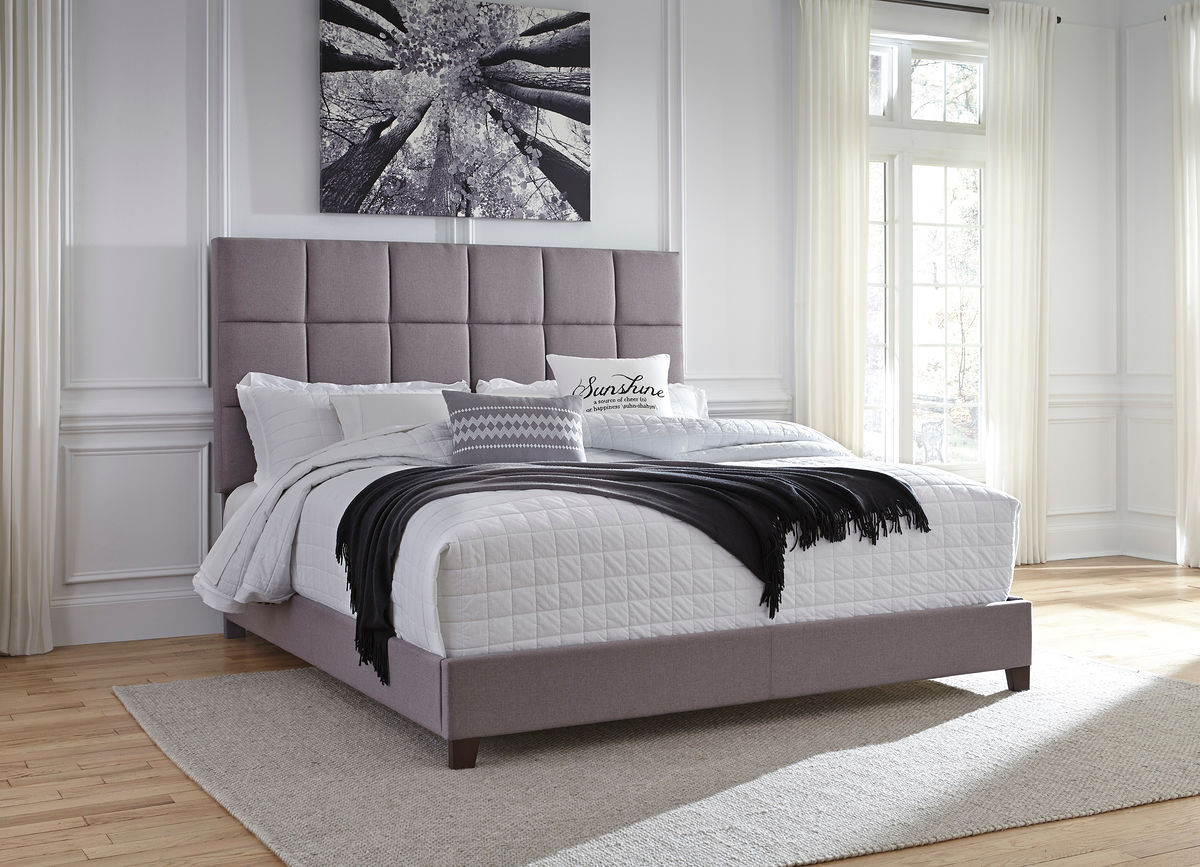 The Contemporary Gray Upholstered King Bed Sold At Managhan S Furniture Serving Libby Mt And The Surrounding Area