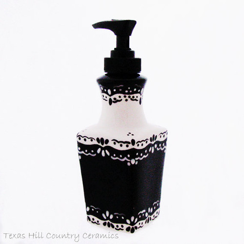 Boutique style soap dispenser with hand painted lace design in black and white.