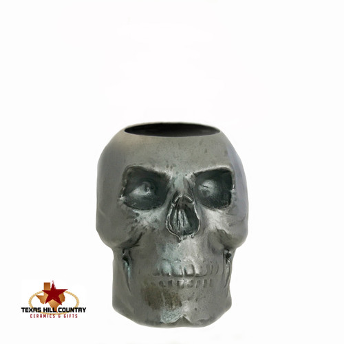 Ceramic skull holder in burnished steel glaze.