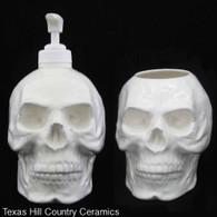 White skull dispenser and toothbrush holder set.