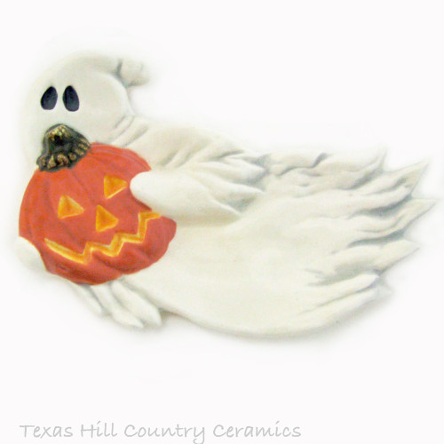 White Ghost holding carved Jack O'Lantern pumpkin tea bag holder or Halloween kitchen decor.