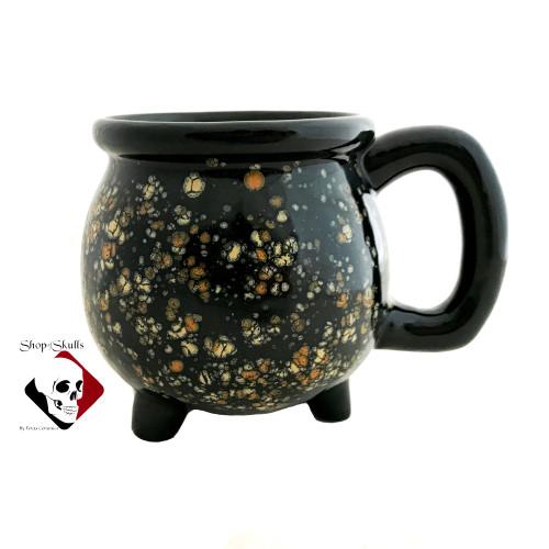 Black cauldron mug with cosmic burst glaze.