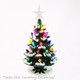 Small green ceramic Christmas tree with snow, color lights and clear star