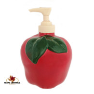 Ceramic apple pump dispenser for kitchen counter or bath vanity.