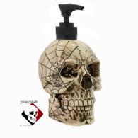 Aged skull with cobweb design with black pump unit.