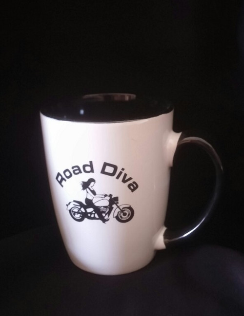 "12oz Java Two Tone Mug Holds 12 ounces White ceramic on the outside and black the inside 4.75"" W x 4.25"" H  Road Diva Products is a retail company and has no affiliation with any motorcycle club."