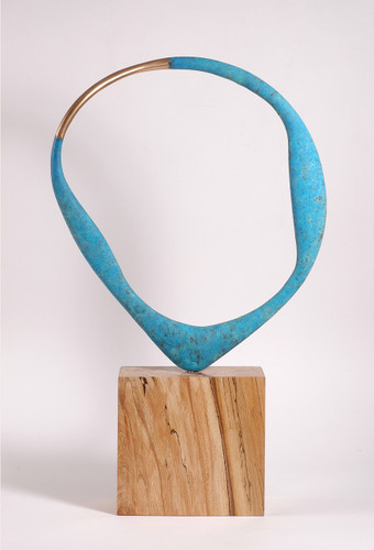 The bronze part has a natural bronze section flanked by oxidized surfaces and the piece freely rotates on the spalted Beech base. This allows the collector to choose any number of views as the piece is asymmetrical.