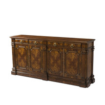 A flame mahogany sideboard by Theodore Alexander