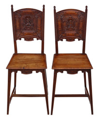 Pair of Continental C1900 carved walnut hall chairs