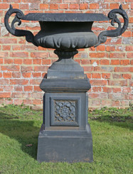 Large cast iron urn on plinth classical planter