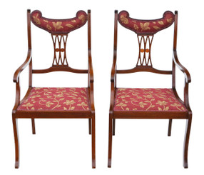Pair of inlaid mahogany elbow chairs C1905