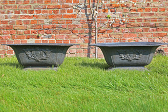 Pair of cast iron planters urns