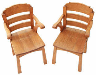 Pair of Arts and Crafts elm oak armchairs