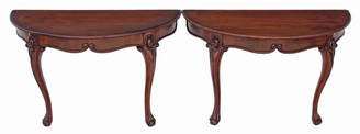 Pair of Victorian carved mahogany console tables
