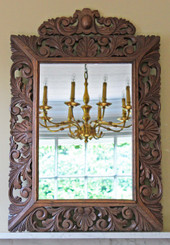 Carved oak Florentine style overmantle wall mirror