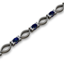 4.76ct t.w Oval Sapphire and Diamond Fashion Bracelet in 14k White Gold