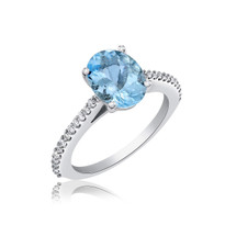 Aqua and Diamonds ring set in 14k gold