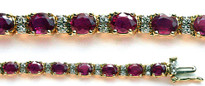 22 Stone Ruby and Diamond Bracelet set in 14k Gold
