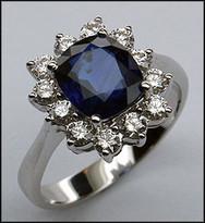 Diamond and Cushion Cut Sapphire Ring