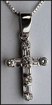 "1"" Diamond Cross set with .66ct Diamonds in 14kt White Gold"