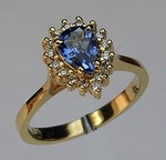Tanzanite Ring surrounded with Diamonds