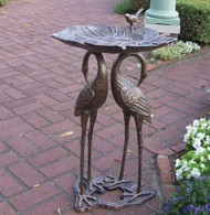 Oakland Living 2 Crane Lily Birdbath OAA1365 Lend a natural touch to the garden path or patio with this eye-catching bird bath, featuring a metal design and crane details. Features      Hardened powder coat     Fade, chip and crack resistant     Rust free cast aluminum and durable cast iron construction     Antique Bronze finish     Easy to follow assembly instructions and product care information     Stainless steel or brass assembly hardware     Some assembly required  Overall     29'' H x 15'' W x 10'' D  Overall Product Weight     30 lb.