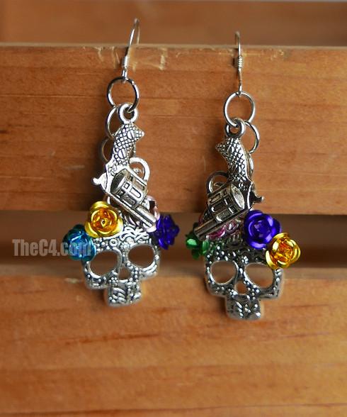 sugar skull and gun earrings
