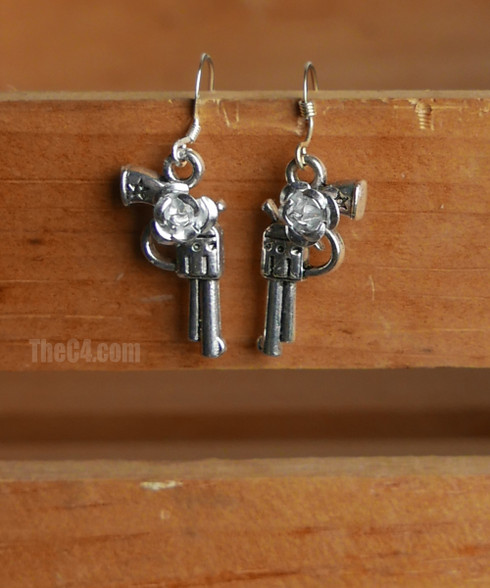 flower and gun earrings