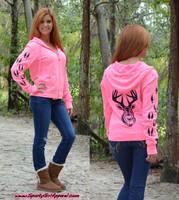 Neon pink zip hoodie with black glitter deer head and tracks