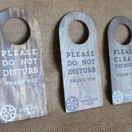 "Wooden ""Do Not Disturb"" Door hanger signs.  Hook fixings.  Sign is light oak stained pine with white wash and printed graphics.  Can be personalised."
