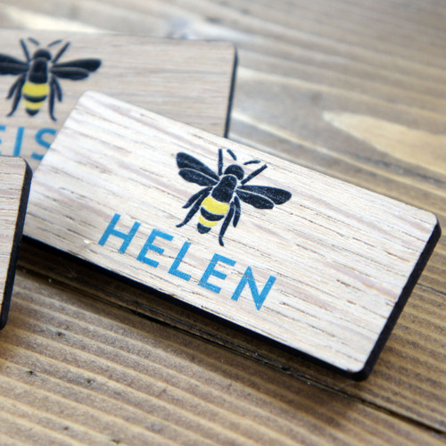 Printed wooden badges with personalised names and company logo