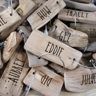Engraved driftwood keyrings as place settings and favours - your guests receive a personalised driftwood keyring to take home