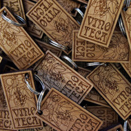 Engraved Cherry Wood keyrings 5mm to 6mm thick - shown with screw connector.  Ideal promotional gifts for businesses and events.