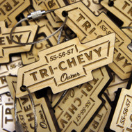 Engraved Maple Wood keyrings 5mm to 6mm thick - shown with screw connector.  Ideal promotional gifts for businesses and events.