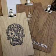 Wooden printed bill presenters. Small wooden bill presenters with single or double sided printing.  Small wooden clipboards with removeable bulldog clip. Colourways include light, dark and grey (sun aged look) oak.