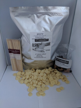 2.5KG White Belgian Fountain Ready Chocolate in resealable foiled bag comes with free pack of Skewers and a 175g bag of Devon Vanilla Fudge