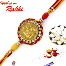 Red & Yellow Rakhi with Ganesh Motif on Coin Shape base - RJ17211