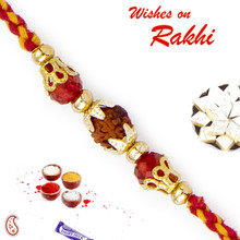 Enchanting Rudraksh Rakhi with Red Beads - RD17418