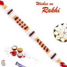 Beautiful Pearl & Maroon Beads Studded Rakhi - PRL17503