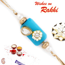 White Floral Bead Rakhi with Blue Base - RB17604