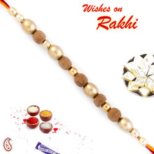 Oval Shape Beige & Golden Sandalwood Rakhi - SW17666