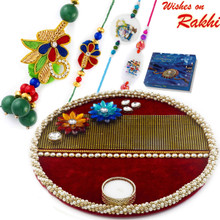Beautiful Floral Motif & Maroon Base Rakhi Pooja Thali with  Family Rakhi Set - RTH1708