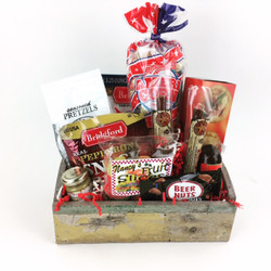 The NYC Brutha Box is for a hard working man who is dedicated to family and taking care of others.  It is in a wooden box filled with proteins and salty snacks to keep him energized throughout the day.