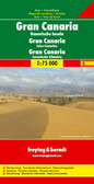 Gran Canaria at 1:50,000 on a GPS-compatible road map from Freytag & Berndt prominently highlighting the island's main places of interest described in a multilingual booklet attached to the map cover. Many place names are in larger size print than found on most maps of the island.   Gran Canaria's landscape is presented by contours and relief shading, with plenty of names of peaks, valleys and other topographic features. Road network emphasises main roads, with interchange names prominently marked, and includes local roads and selected country tracks. Driving distances are marked on main routes. Scenic roads are highlighted, as are hiking trails. Icons indicate various facilities and places of interest, including campsites, viewpoints, etc. The island's best sights are prominently highlighted and described in the accompanying booklet attached to the map cover. The map has a 5km UTM grid plus latitude and longitude margin ticks at 2' intervals. The index, also in the booklet, lists locations with their GPS coordinates. Map legend and the text of sights descriptions include English.