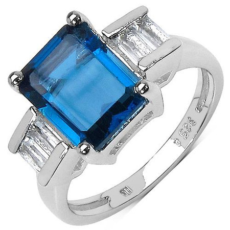 4 2/5 CTW Solitaire Octagon Cut Blue Topaz and Baguette Cut White Topaz Cocktail Ring in .925 Sterling Silver - #BMS150195