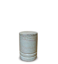 Toscano Natural Beige Marble Keepsake Urn For Ashes  This urn is crafted from a natural marble in a seashell beige color, with thin to medium grain and irregular background. The main characteristic of this marble is the appearance of strong and well defined vein. This vein is moderately irregular, but it is what defines the uniqueness of this stone. Quarried and made from 100% real natural marble.  Because it is natural, the color and pattern in each urn will vary.  The lid can be sealed with adhesive that can be found at a local hardware store.  Adhesive is included.  It's the perfect vessel as a keepsake for display in your home, niche, funeral, columbarium, burial, scattering ashes, or as a reminder and in remembrance of their love and spirit.