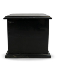 Modern Black Marble Cremation Urn for Ashes - This traditional black marble urn is hand crafted from 100% pure marble.  Each urn is perfectly turned from a solid piece of marble and polished to shine.  Black is a classic color of timeless beauty.  The main characteristic of this black marble are the purity, deep blacks and minimal white veining. Quarried and made from 100% real natural marble. Hand crafted from a solid piece of marble and polished to shine. Because it is natural, the color and pattern in each urn will vary.  The bottom is lined with felt to prevent scratches and provide stability and includes a threaded lid to secure ashes.  It's the perfect vessel as a keepsake for display in your home, niche, funeral, columbarium, burial, scattering ashes, or as a reminder and in remembrance of their love and spirit.  Memory Cremation Urns