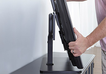 Connect the TV to the base, and adjust the height and swivel for the perfect TV viewing experience
