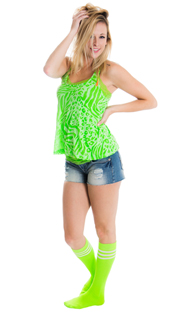 woman wearing neon green tube socks and jean shorts